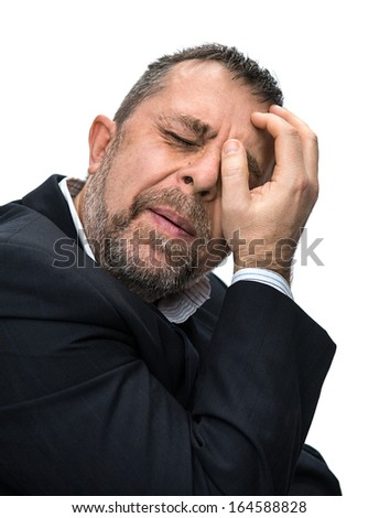 Headache. Portrait of an middle age man with face closed by hand. Isolated on white  - stock photo