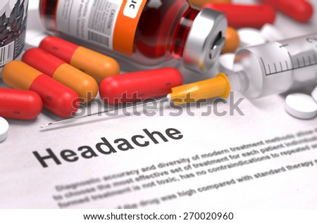 Headache - Printed Diagnosis with Blurred Text. On Background of Medicaments Composition - Red Pills, Injections and Syringe. - stock photo