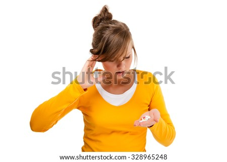 Headache - woman holding pills isolated on white background
