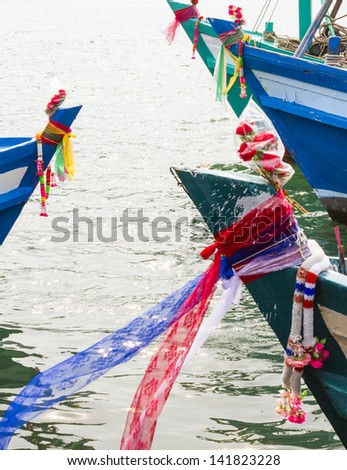 Header of fishing boats, colorful fabric on header of fishing boats on the beliefs of the native Thailand. - stock photo