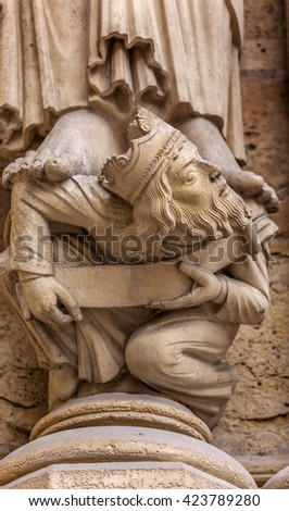 Headless King Facade Notre Dame Cathedral Paris France.  Notre Dame was built between 1163 and 1250AD.   - stock photo