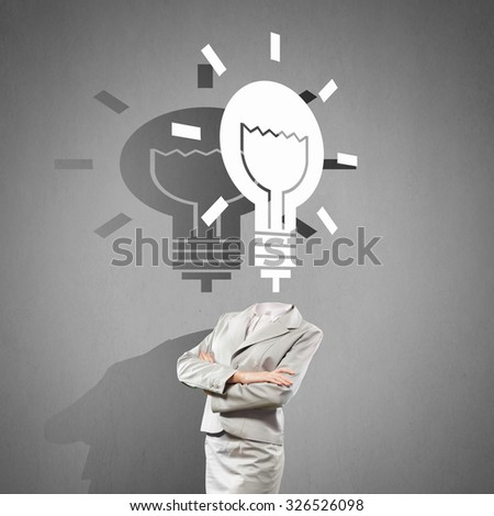 Headless woman with light bulb instead of head