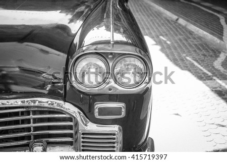 headlight lamp of vintage classic car in black and white filter