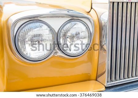 Headlight lamp vintage yellow car. - stock photo