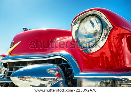 headlight of a oldtimer in front of blue sky - stock photo