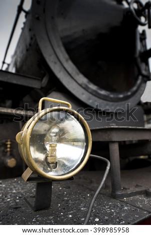 Headlight of an old steam locomotive - stock photo