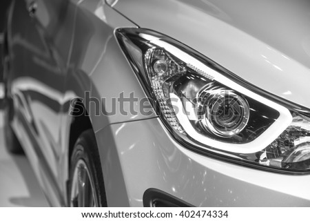 headlight of new automobile - stock photo
