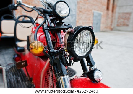 Headlight of old red retro motorcycle - stock photo