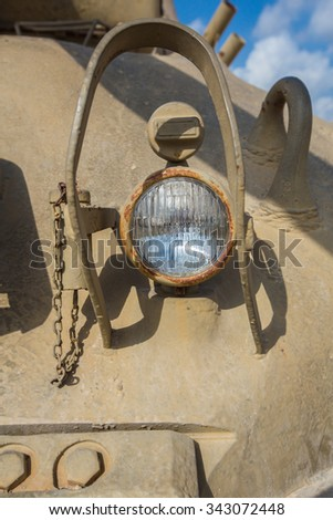 Headlight of the old military equipment close-up