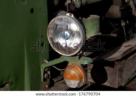 Headlight of the old tractor - stock photo