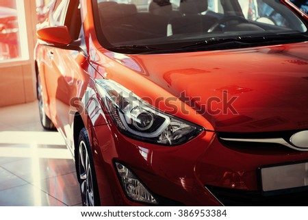 Headlights and hood of sport red car - stock photo