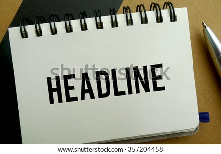 Headline memo written on a notebook with pen - stock photo