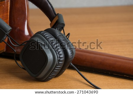 headphone and guitar on wood