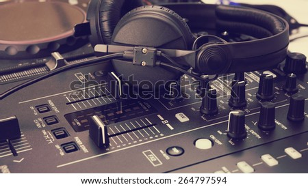 Headphone on dj mix console and music mixer - stock photo