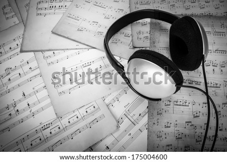 headphone on music sheet - stock photo