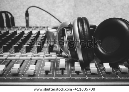 headphone on sound mixer background. - stock photo