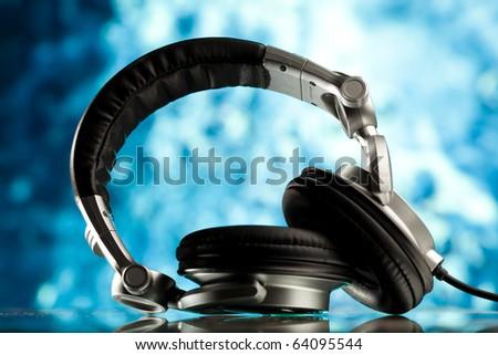 headphones against blue background - stock photo