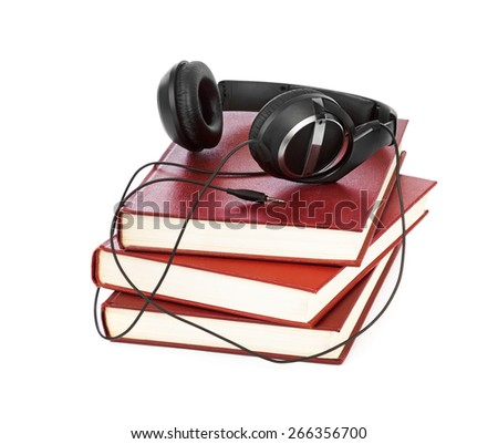 Headphones and books isolated on white background - stock photo