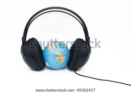 Headphones and globe on white background