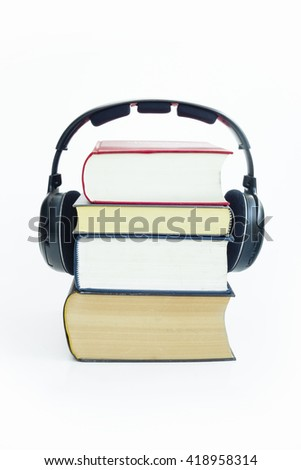 Headphones and group of books with isolated white background. The image refers to audio books, e-books.