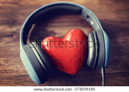 Headphones and heart concept for love listening to music - stock photo