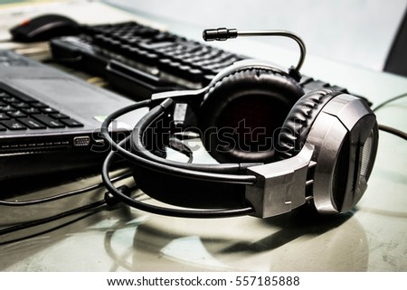 Headphones and keyboard on table