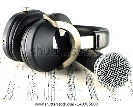 headphones and Microphone on Musical notes - music concept - - stock photo