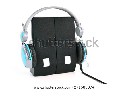 Headphones and speaker on white background