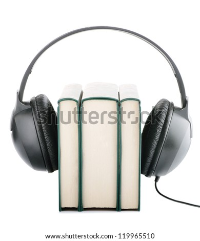 Headphones around books suggesting listening to books instead of reading them