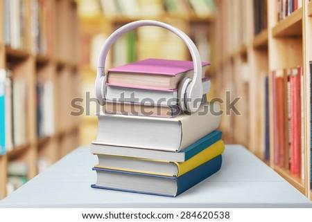 Headphones, Book, Audio Equipment. - stock photo