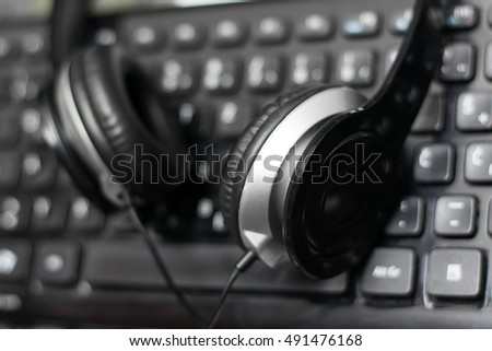 Headphones close up on laptop keyboard