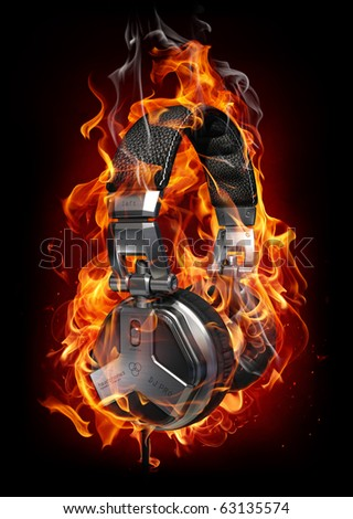 Headphones in fire. My own design made for the image. Logo is a fake. - stock photo