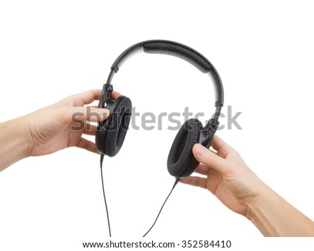 Headphones in hands on a white background - stock photo