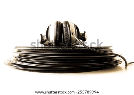 Headphones lying on the stack of vinyl records. Music concept. - stock photo