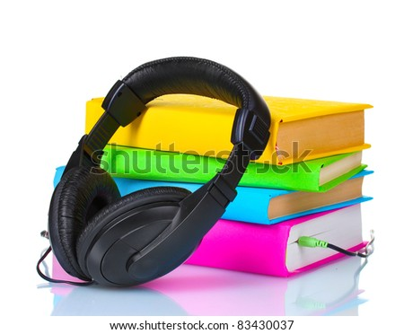 Headphones on books isolated on white
