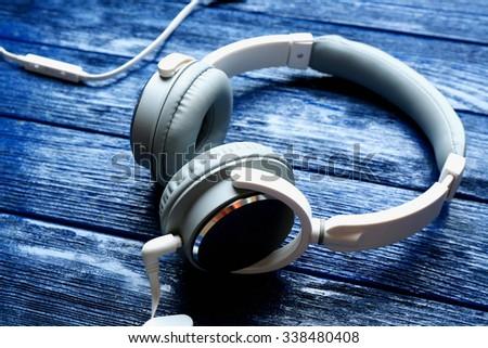 Headphones on dark blue background - stock photo