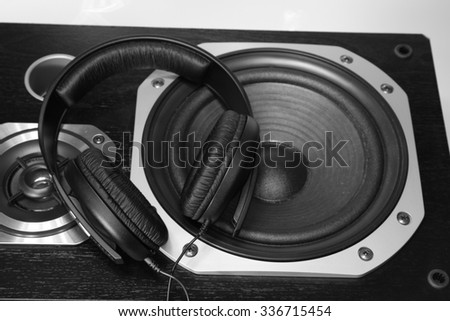 Headphones on stereo speakers - stock photo