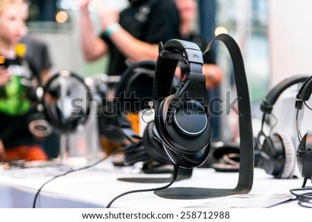 Headphones on the ground against blue background - stock photo