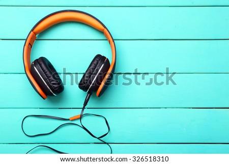 Headphones on wooden background - stock photo