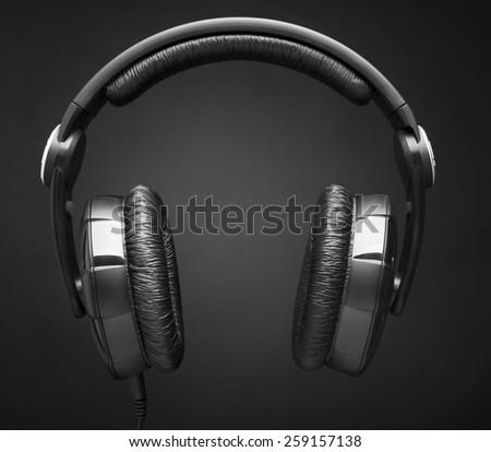 Headphones over black background - stock photo