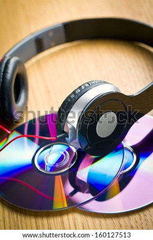 headphones with cd on wooden table