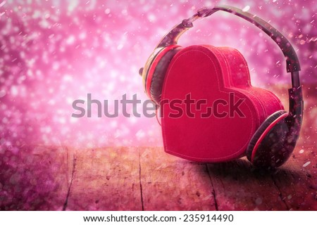 Headphones with red  heart on wood table. Sweet  music of love. vintage retro - stock photo