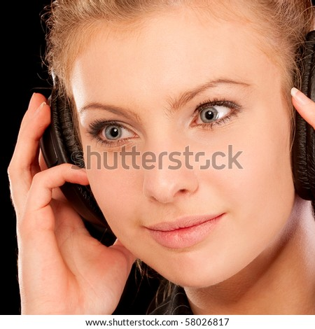 Headphones woman, isolated on black background.