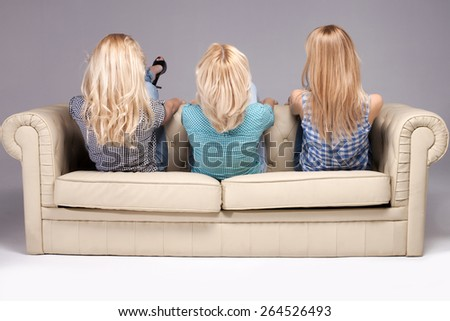 Heads of three blonde girls with long hair. Hairstyle.