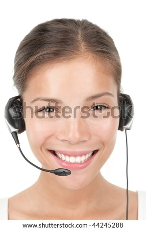 Headset woman portrait.. Closeup of beautiful young mixed race chinese / caucasian secretary / assistant speaking with headphones while working in call center. Isolated on white background. - stock photo