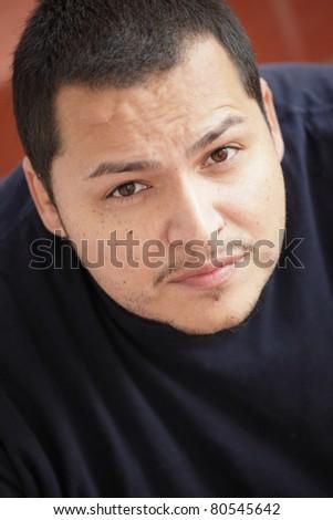 Headshot of a Hispanic man - stock photo
