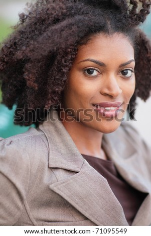 Headshot of an attractive young woman - stock photo