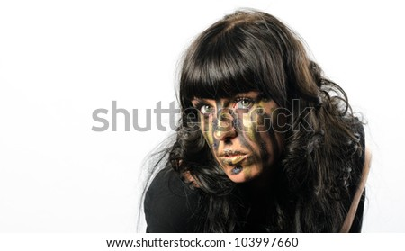 Headshot of darkhaired girl with facepaint streaks against a white background - stock photo