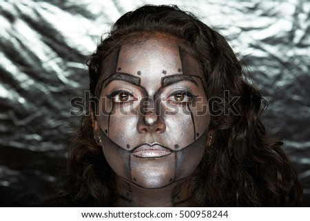 headshot of women with body art  metal mask on face