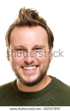 Headshot photo of white Caucasian male with a beard, blue eyes and brown hair. He is staring right at the camera with a happy expression. Big toothy smile.